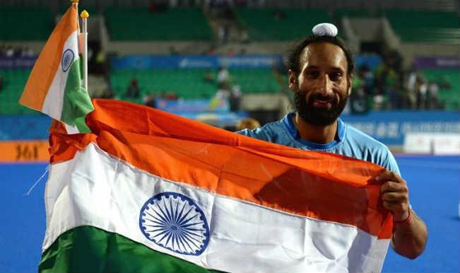 Sardar Singh with flag